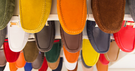 plimsoll: variety of the colorful leather shoes in the shop Stock Photo