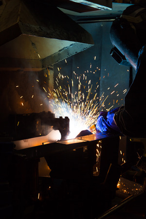 fabricator: Team work is welding skills up. Manufacturing of car. Stock Photo