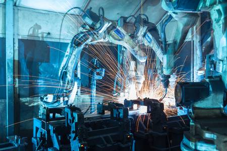 factory line: Team welding robots represent the movement. In the automotive parts industry. Stock Photo