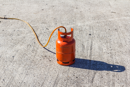 gas cylinder: Red gas cylinder Stock Photo