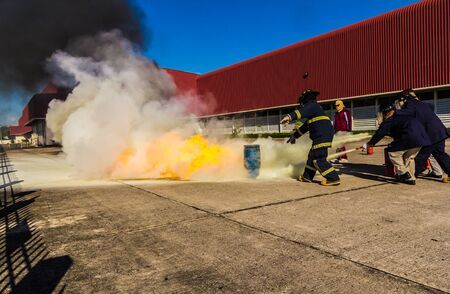 heroism: Firefighters fighting fire during training