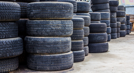 Old used tires stacked with high piles Stock Photo