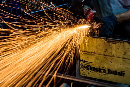 sparks: Angle grinder sparks close-up