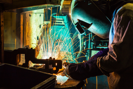 fabricator: sparks while welder uses torch to welding