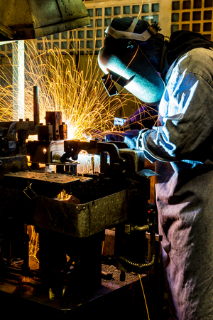 laboring: work is welding skills up. Manufacturing of car. Stock Photo