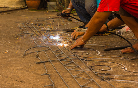 electrode: welder working with electrode in arc welding in construction outdoors Stock Photo