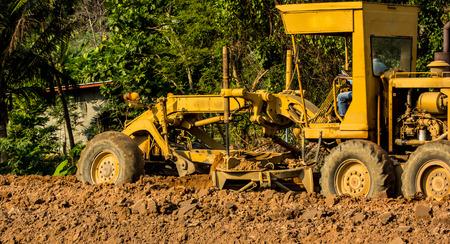 sandpit: bulldozer blade, industrial machines working in sandpit on construction site