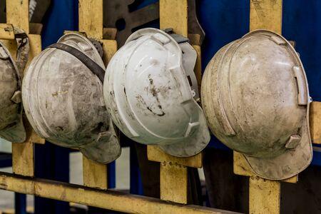 1 object: White hard hat Plastic safety helmet