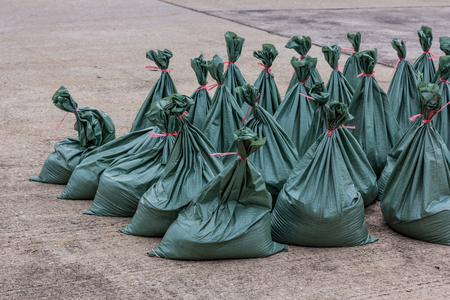 fossilized: Sand bags help keep flood waters out Stock Photo