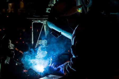argon: Welder is welding automotive part in factory