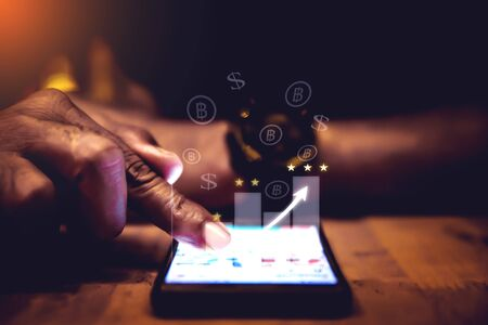 Augmented Reality Financial Chart (AR) shows increased revenue. Soaring above the digital screen, smart phones, business people are meeting about strategies for growth and success.