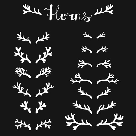 horny: Set of hand drawn deer horns white on the black background, silhouette of antlers.