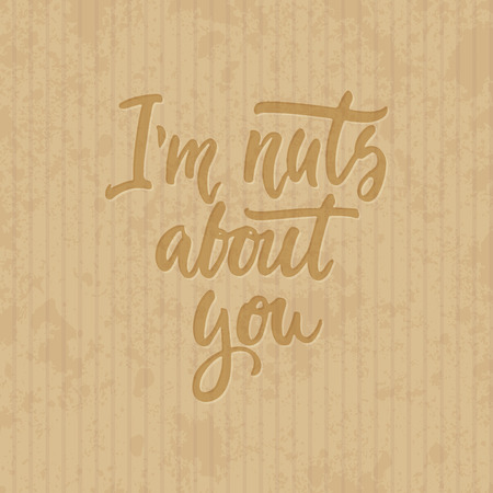 about you: Im nuts about you - hand drawn lettering phrase isolated on the cardboard grunge background. Fun brush ink inscription for photo overlays, greeting card or t-shirt print, poster design. Illustration