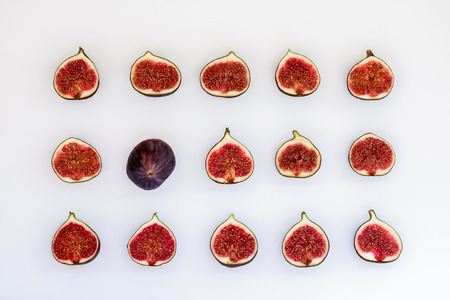 Pattern of sliced ripe figs in the form of rectangle isolated on white background. Fruit illustration. Food photo. Flat lay, Top view. Stock Illustration - 89875012