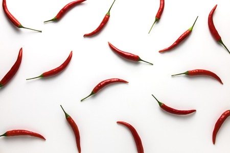 Red hot little chili peppers pattern isolated on white background. Top view. Flat lay. 写真素材