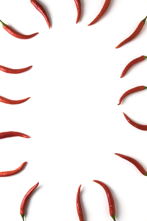Red hot little chili peppers pattern with copyspace isolated on white background. Top view. Flat lay.