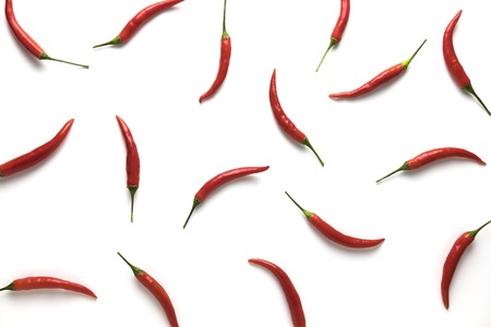 Red hot little chili peppers pattern isolated on white background. Top view. Flat lay. Stock Photo