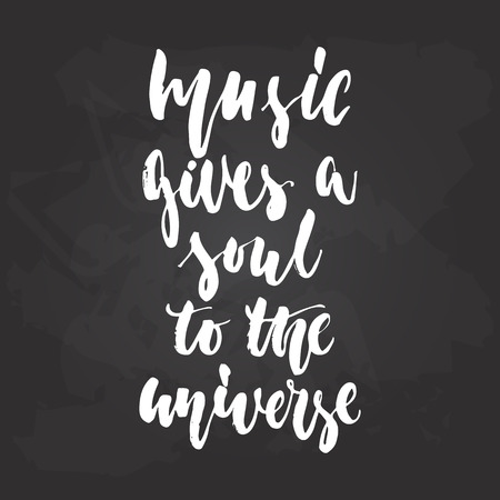 Music gives a soul to the universe - hand drawn Musical lettering phrase isolated on the black chalkboard background.