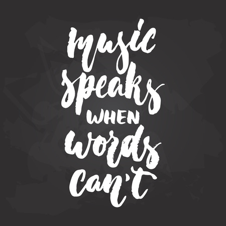 Music speaks when words cant - hand drawn Musical lettering phrase isolated on the black chalkboard background.