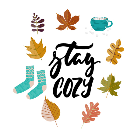 Stay cozy - hand drawn Autumn seasons holiday lettering phrase and Hugge doodles with leaves, cup of tea, cocoa, chocolate, warm socks isolated on white. Ink illustration for banners, cards, posters Illustration