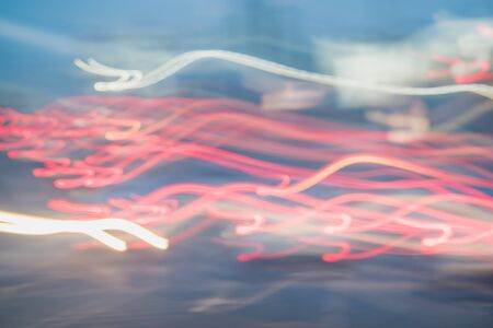 Abstract bright blurred neon trend background, multi-colored lines. Speed light beam night traffic and lights.