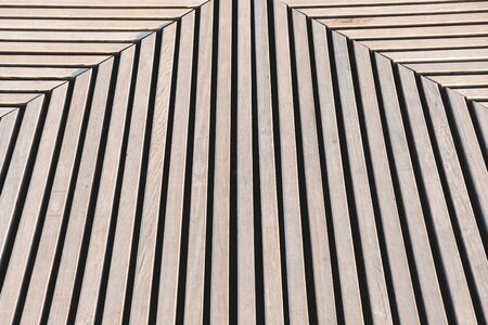 Abstract wooden striped background with pronounced shadows.