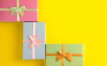 Gift box on sunny yellow background. The concept of the New Year, Christmas, Birthday, Anniversary. Top view. Flatlay. 写真素材