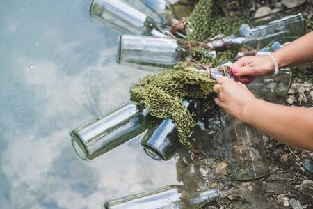 Bottles connected with notes inside float by the lake. Quests, games, adventures.