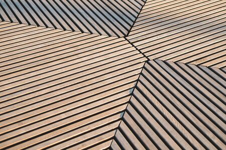 Abstract wooden striped  with pronounced shadows. Banco de Imagens