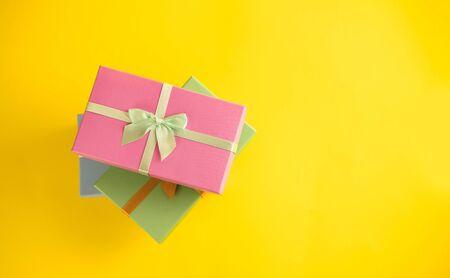 Gift box on sunny yellow