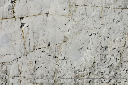 Concrete grey rock texture wall with small stones. Textural natural background. Copyspace