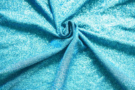 Colored blue shiny fabric texture with folds. Surface background colors of the year 2021 Reklamní fotografie - 159019631