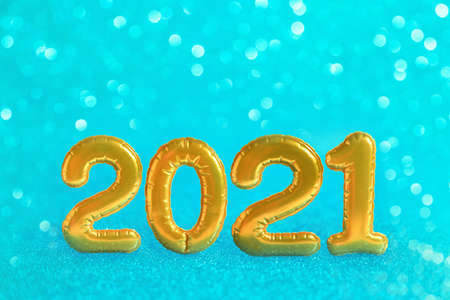 Christmas festive background with golden numbers 2021. Abstract glitter blurred background shiny blue ai aqua. Bright sparkling wallpaper with bokeh texture Reklamní fotografie - 159019989