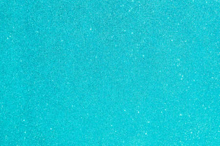 Abstract glitter blurred shiny blue aqua background. Bright sparkling bokeh wallpaper style. Festive Christmas holiday futuristic texture.