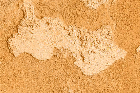 Concrete orange colorful wall surface texture. Abstract grunge bright marigold color background with aging effect. Copyspace. Trendy color of the year 2021.