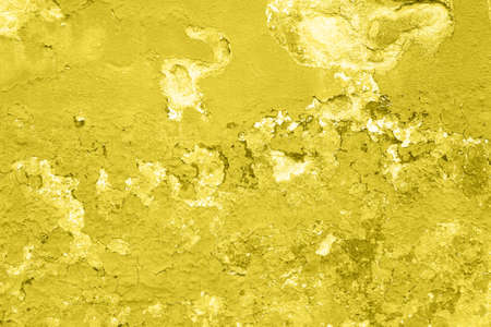 Concrete Yellow colorful wall surface texture. Abstract grunge bright illuminating color background with aging effect. Copyspace 版權商用圖片