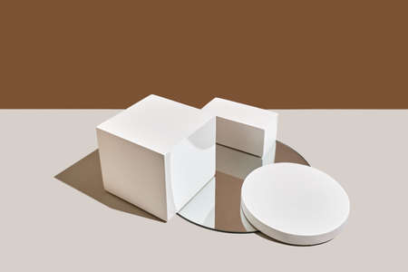 Empty white round and rectangular podium, mirror with shadows on beige natural background. Wabisabi style, earth tone. Mockup for the presentation of eco or organic products, cosmetics. Reklamní fotografie