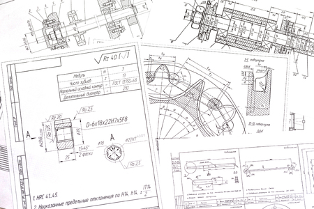 Technical drawings of the parts a few pieces laid out on the table Stockfoto