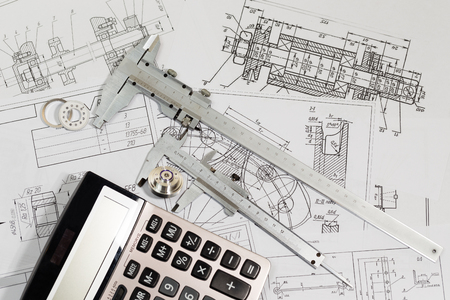 Engineering drawings & measuring instrument - Vernier caliper, coursework or thesis project. Project engineer. Stock Photo - 47475725
