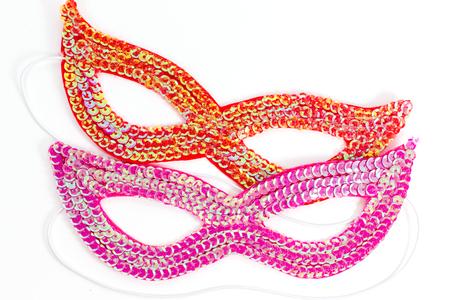 The facemask. Two pieces: red and crimson on a white background.