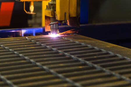 cutting metal: Cutting metal. Modern technologies of production of Universal equipment for the manufacture of parts, cutting of sheet steel with laser, plasma or gas. Stock Photo
