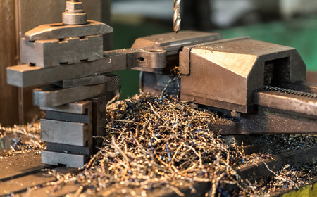 Drilling machine, machine studded with steel shavings.