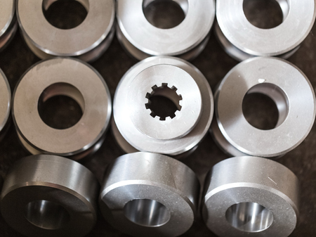 Steel round parts - bushings, rollers, rollers. All the details are the same and only one differs in the form of inner hole. The hole has splines.