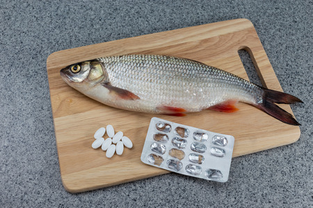 Fish and pills. The risk of food poisoning, infection with worms. Or preparation of medicines from fish. Reklamní fotografie