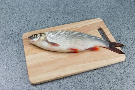 Diet food, natural food. Fish on a cutting Board.