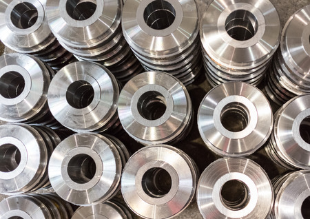 Rollers, rollers, bushings - billet obtained on a lathe from steel and cast iron. Many of the same parts stacked in the shop machine factory. Expect further processing. Reklamní fotografie