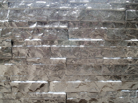 pattern gray color stone wall background , modern style design decorative real stone wall surface