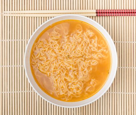 the instant noodles: Instant noodles on wood background