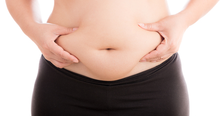 fat: Cellulite fat at belly on white background Stock Photo