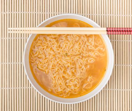 Instant noodles on wood background